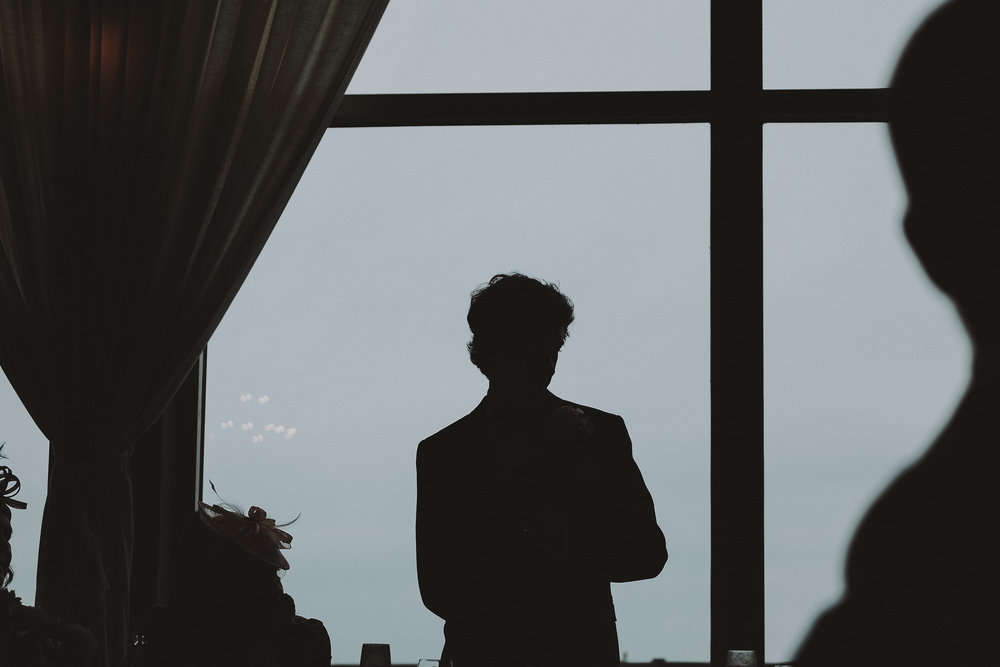 A silhouette of the groom giving his speech at Newton Hall Northumberland by Barry Forshaw