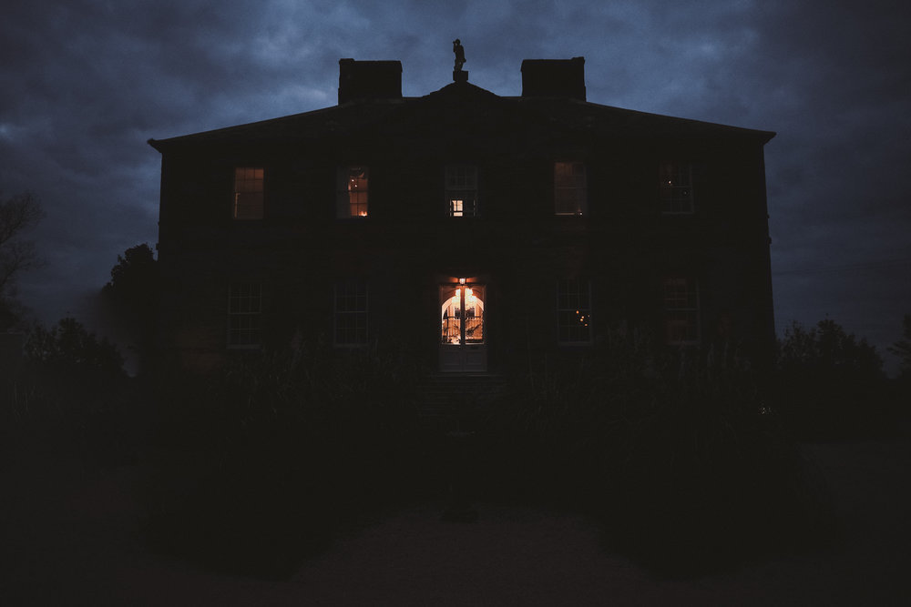 A dark and moody photo of at Newton Hall Northumberland at the end of the wedding day by Barry Forshaw