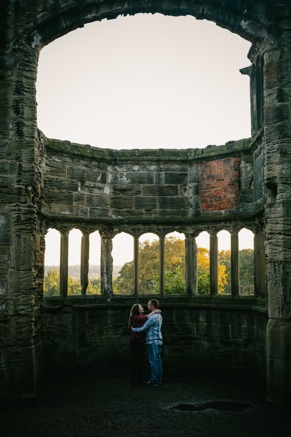 Jen & Joe cuddle in the ruins of St Catherine's Chapel Sunderland on their pre-wedding photo shoot
