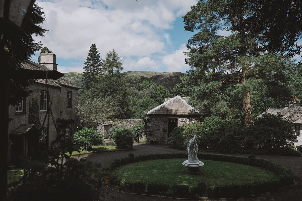 The traditional Lakeland buildings that make up Monk Coniston Hall at Julia and Darren's Lake District wedding by Barry Forshaw