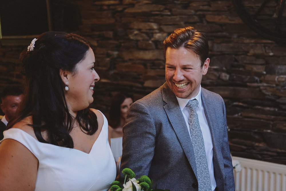 The bride and groom share a laugh at Julia and Darren's Lake District wedding by Barry Forshaw