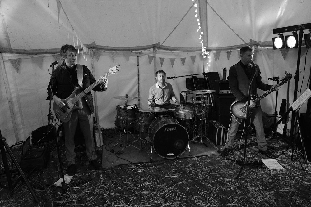 A black and white photo of the band playing at Julia and Darren's Lake District wedding by Barry Forshaw
