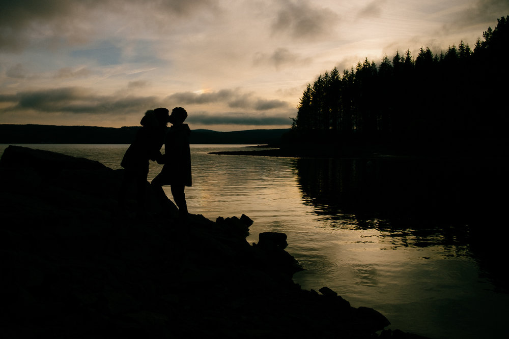 Silhouette of a couple kissing at Kielder reservoir