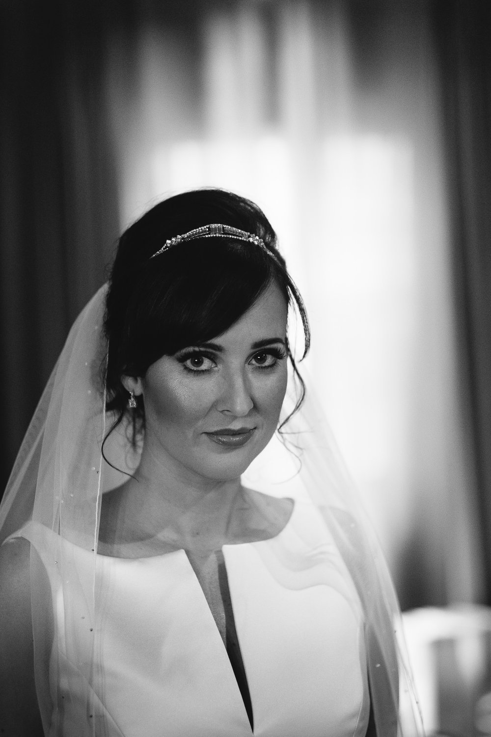Black and white photo of the bride at le petit chateau