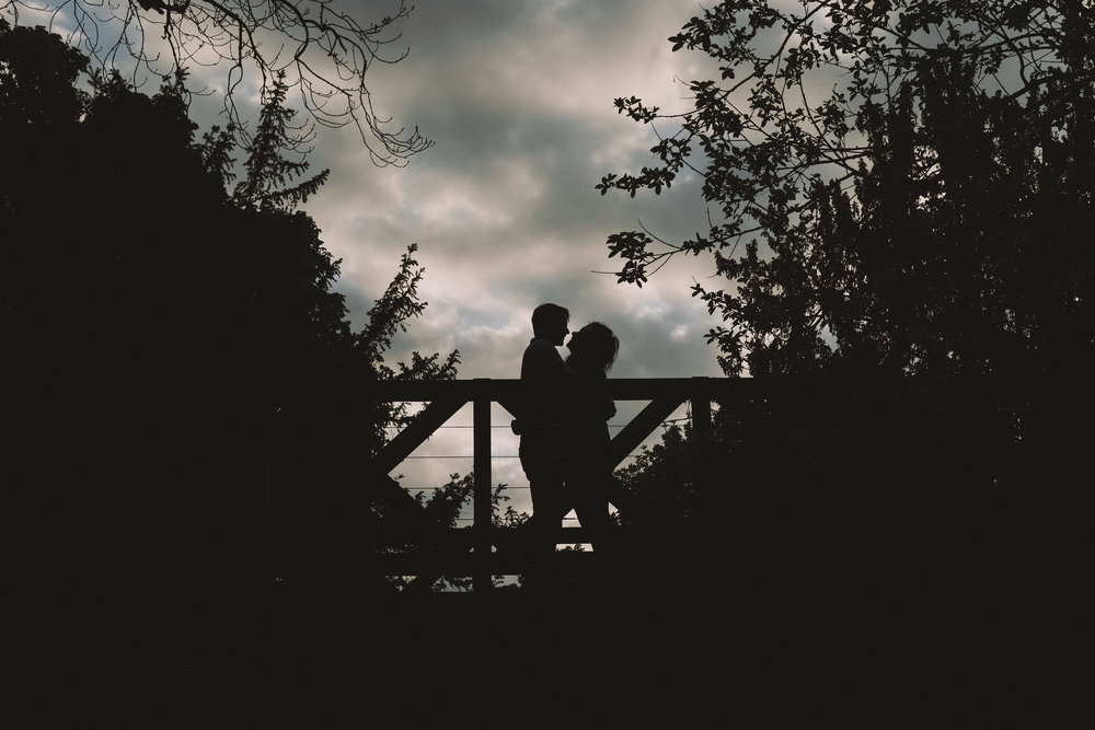 Silhouette of couple on bridge during engagement shoot in Gateshead