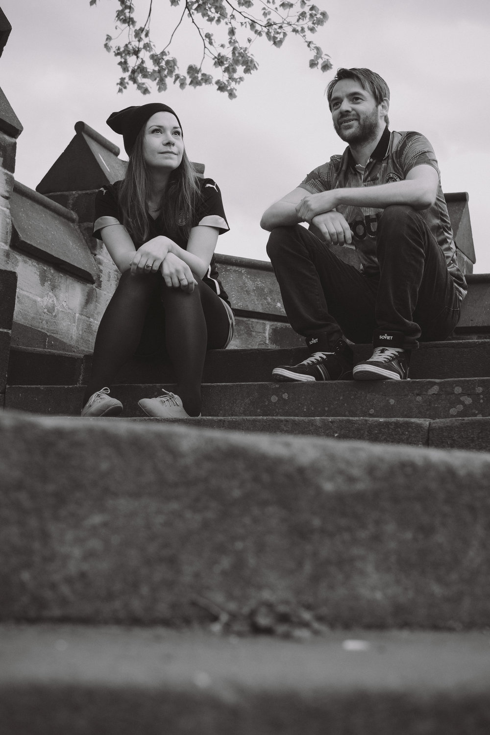 Black and white photo of couple sitting on steps in Saltwell Park