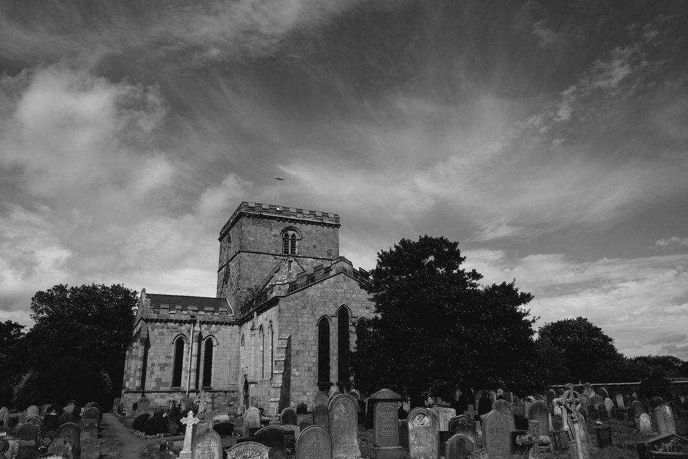 Black and white photo of St Oswalds Church in Yorkshire