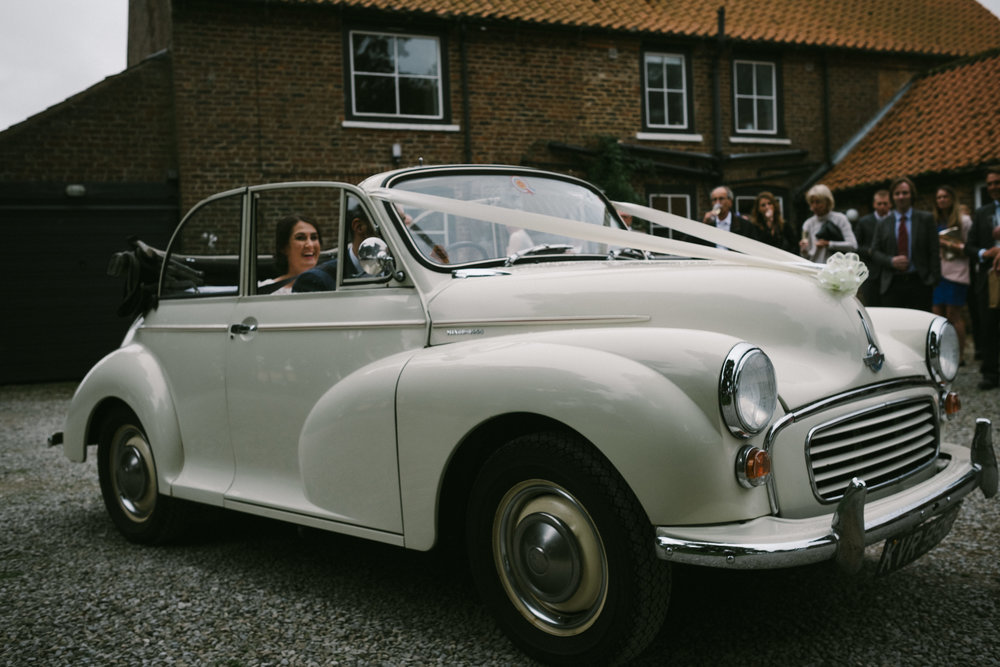 Bride arriving at Dale Farm in her car after the wedding ceremony