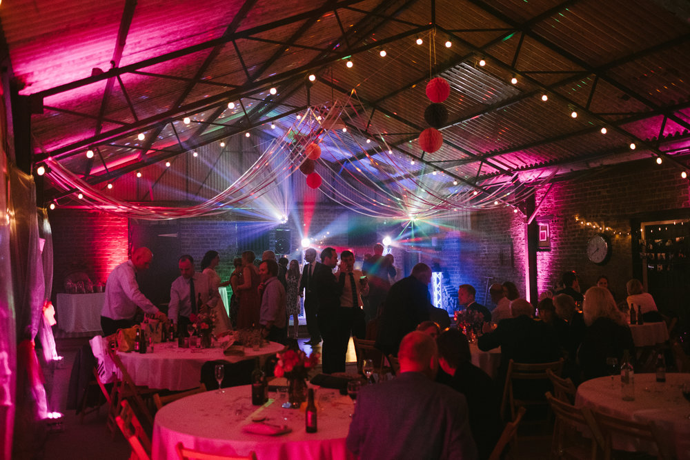 Marquee and dancefloor bathed in disco lights at Dale Farm