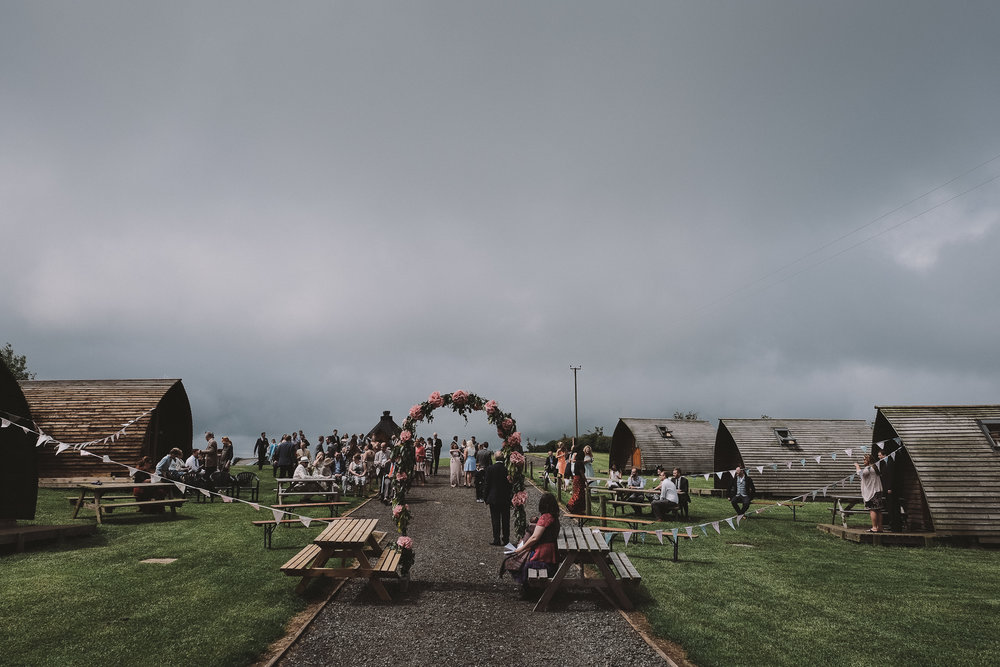 Outdoor wedding ceremony set up on the Northumberland coast with flower archway
