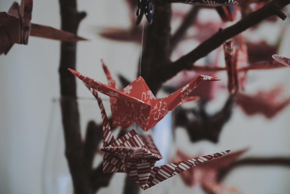 Close up of a paper crane at a DIY wedding