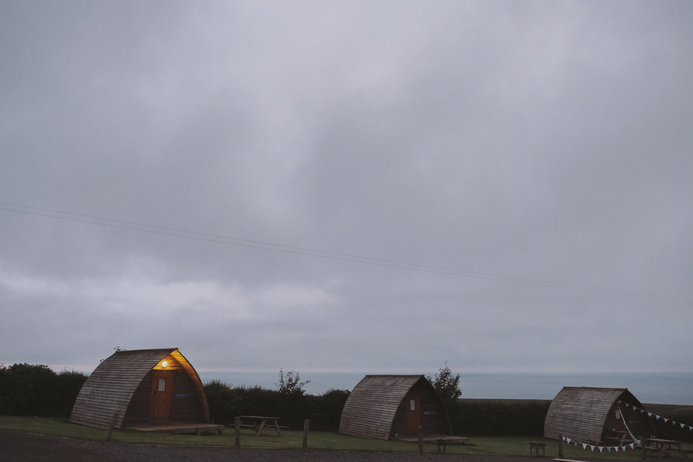 Wooden wigwams at sunset at Potadoodledoo