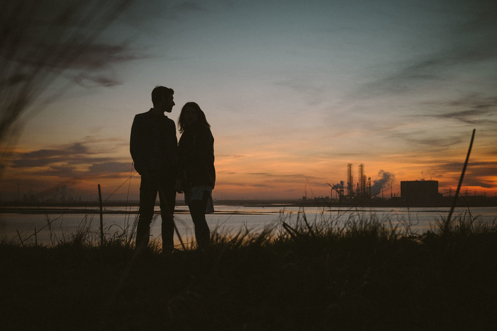 Silhouette of couple at sunset on Teeside coast