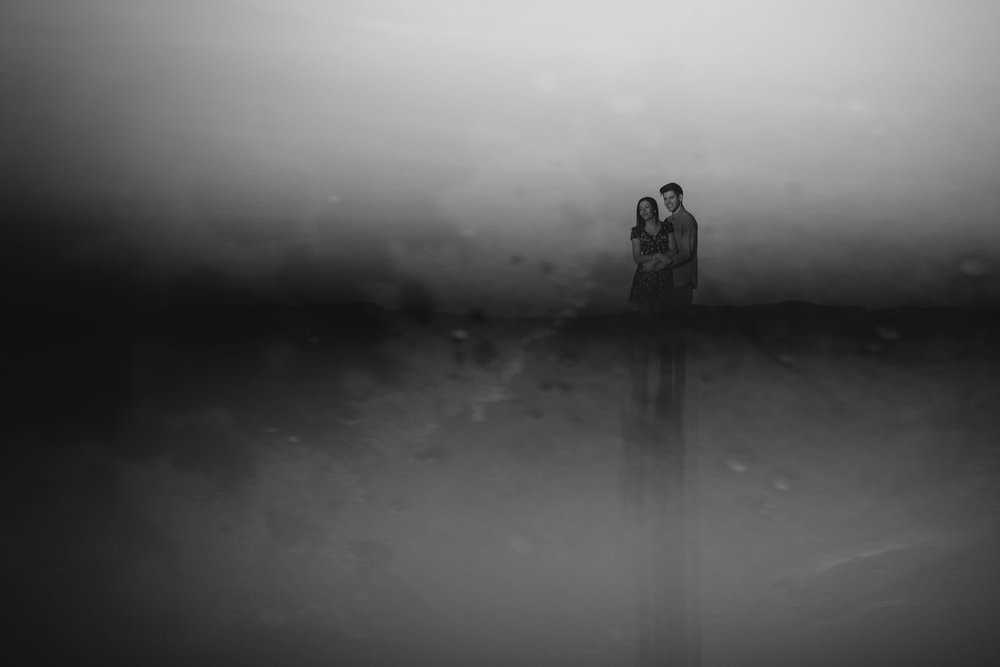 creative and minimalist black and white photo of couple reflected in prism