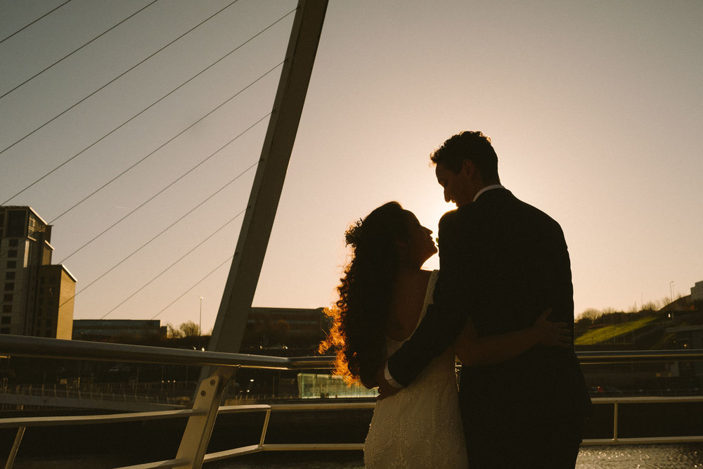 Silhouette of bride and groom on Newcastle Quayside