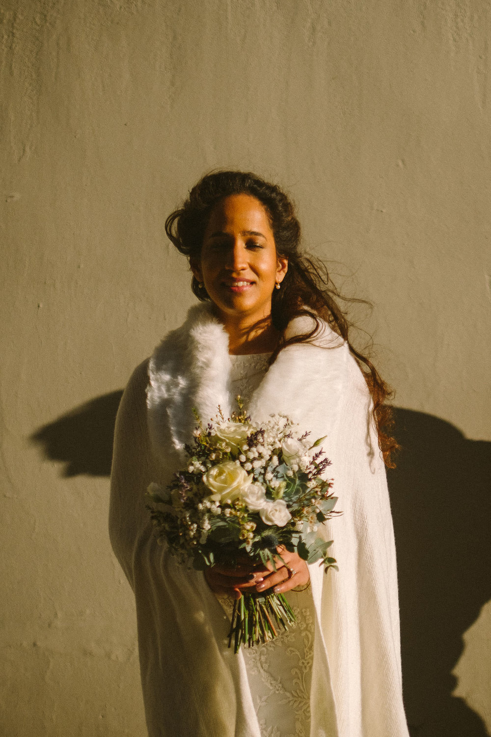 Bride closes eyes as warm winter suns washes over her