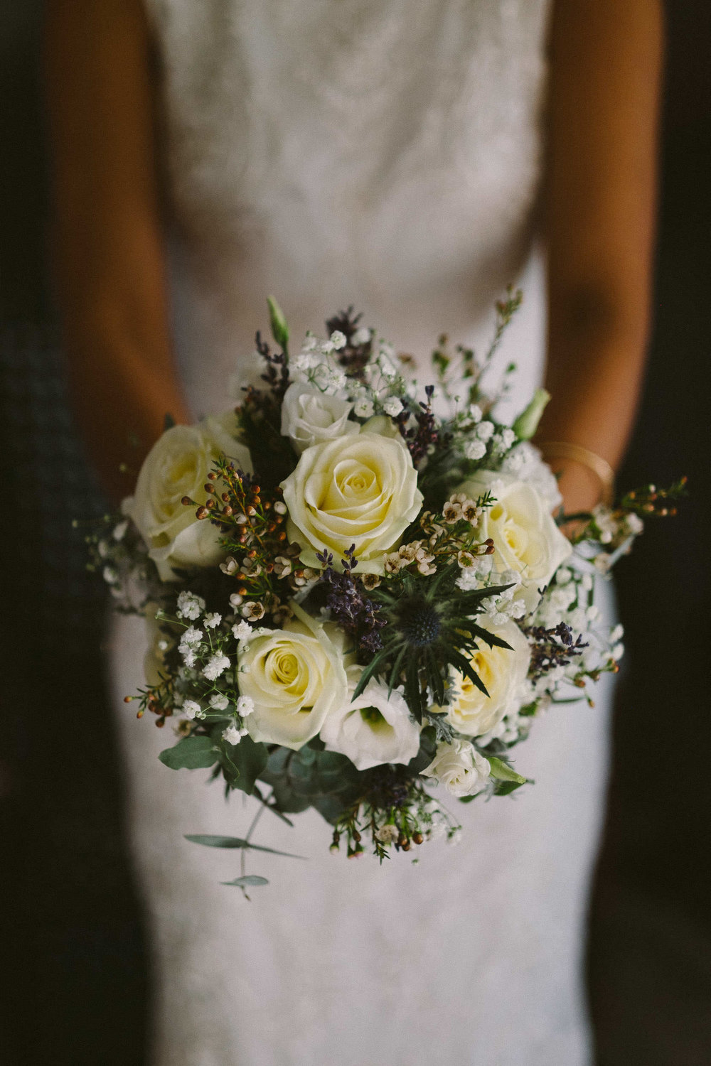 Close up of bride's bouquet with white roses