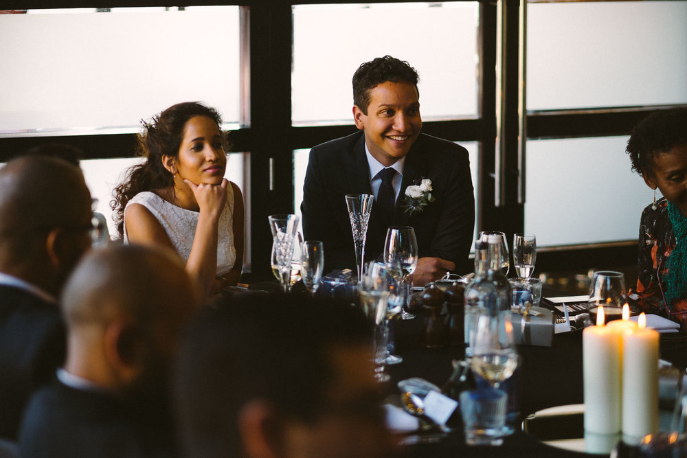 Bride and groom in conversation with guests at wedding