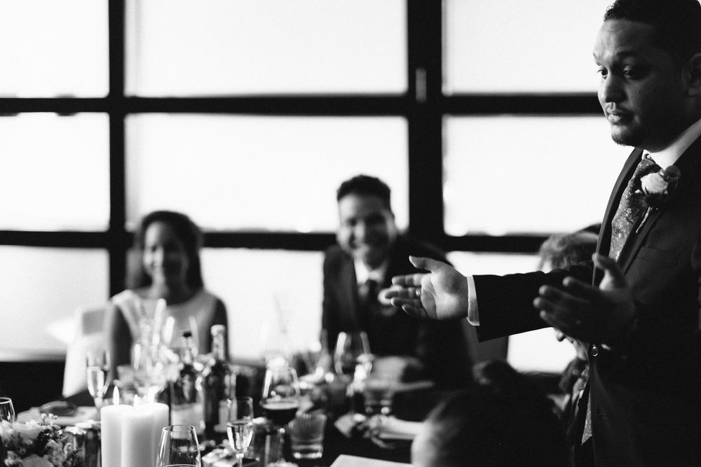 Black and white photo of best man's speech at Malmaison wedding