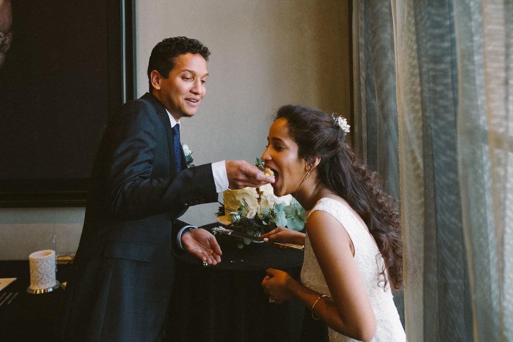 Groom feeds bride wedding cake at Malmaison Newcastle