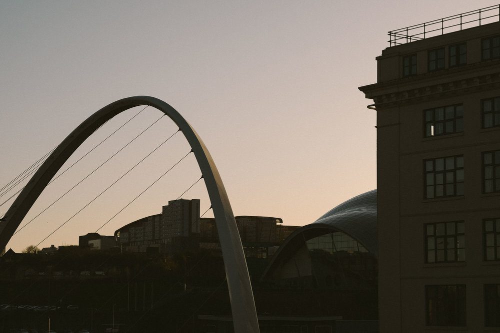 Silhouette of Millennium Bridge and Malmaison Hotel Newcastle upon Tyne