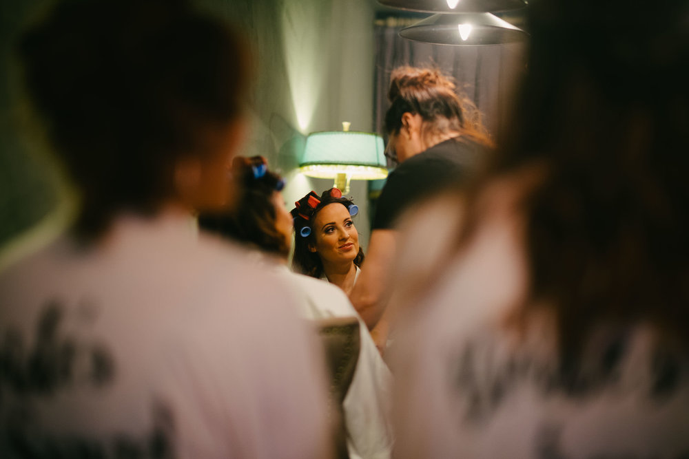 Bride with curlers in her hair at Le Petit Château