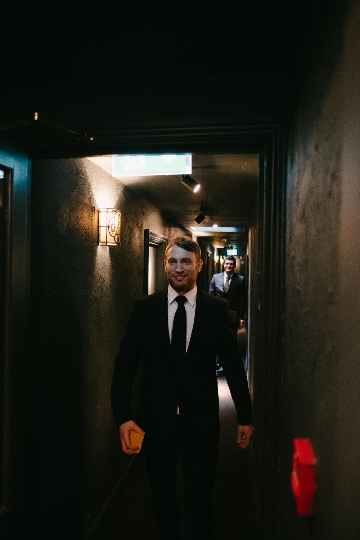 Groom and groomsmen walk to the wedding ceremony
