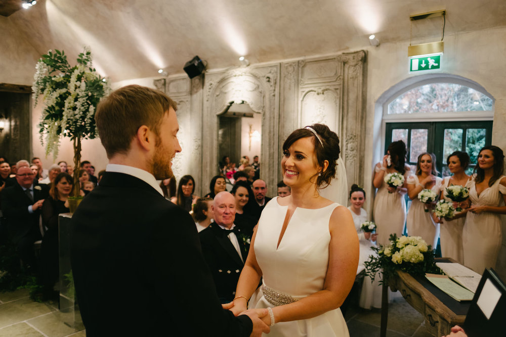 Bride and groom laughing during wedding at Le Petit Château