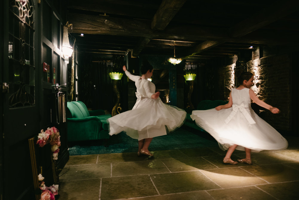 Girls spin their dresses at Le Petit Château wedding