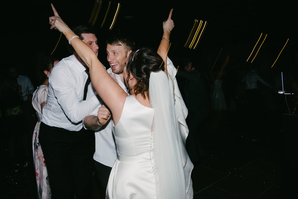 Bride and groom partying at Le Petit Château
