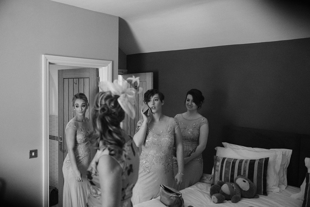 Black and white photo of bridesmaids getting ready for wedding