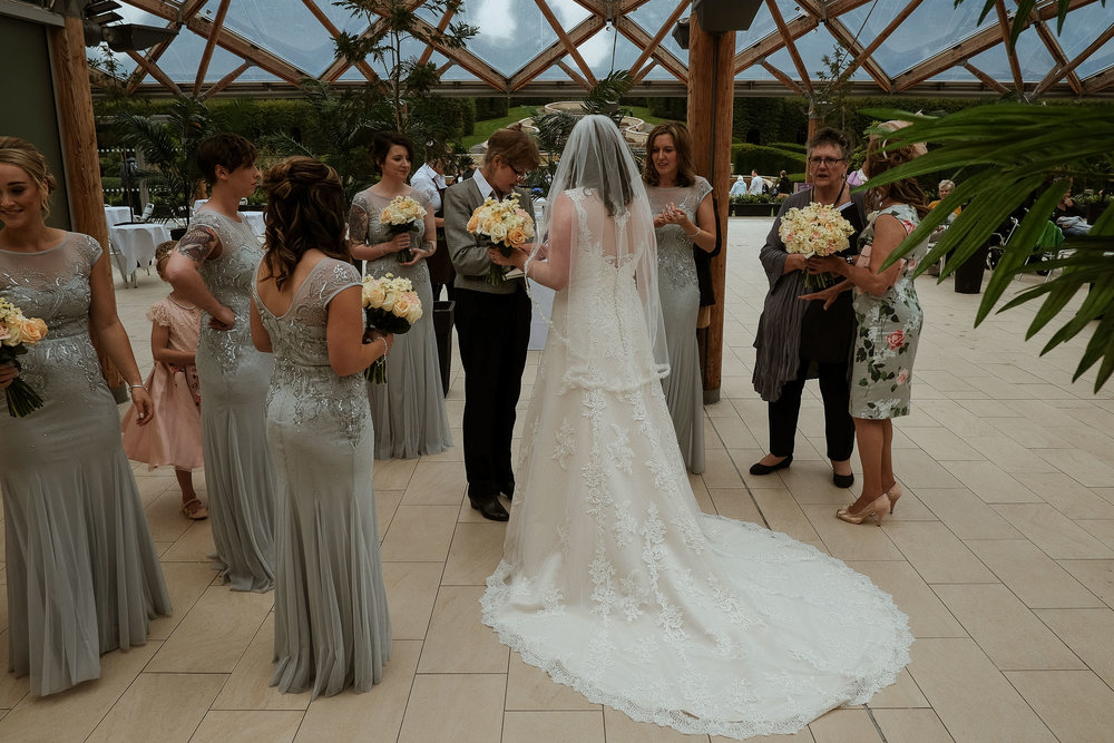 Bride and bridesmaids about to enter wedding ceremony at the Alnwick Garden