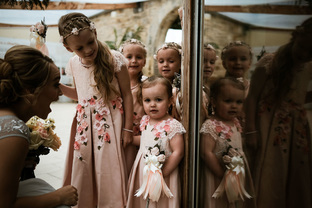 Flower girls reflected in window at the Alnwick Garden