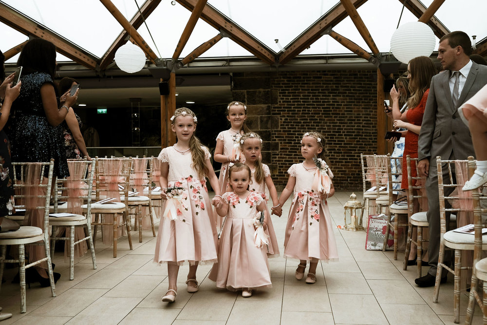 Flowergirls walking into ceremony at the Alnwick Garden