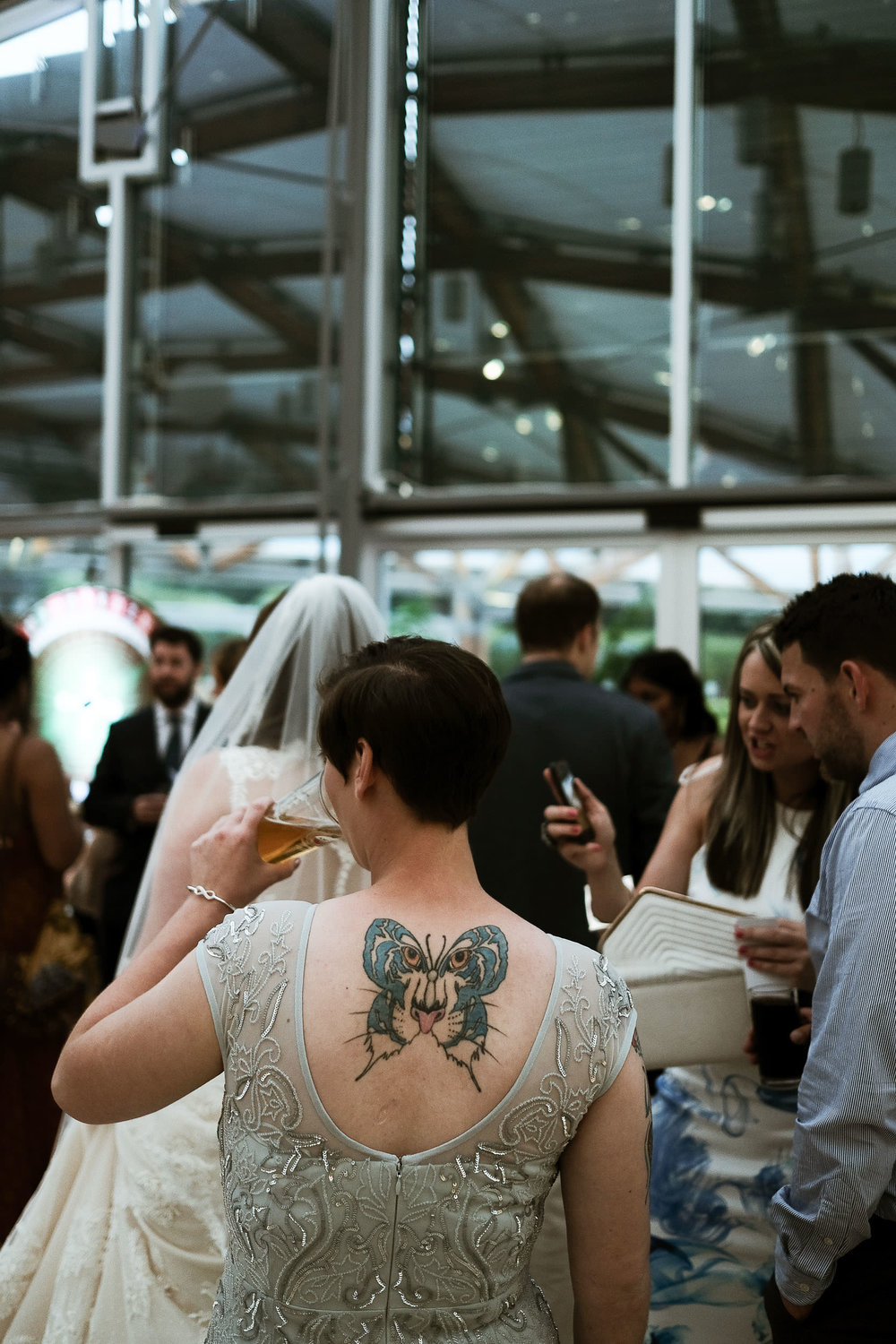 Close up of bridesmaid's colourful tattoo