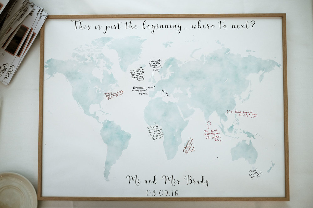 Map of the world gift to bride and groom with guest comments