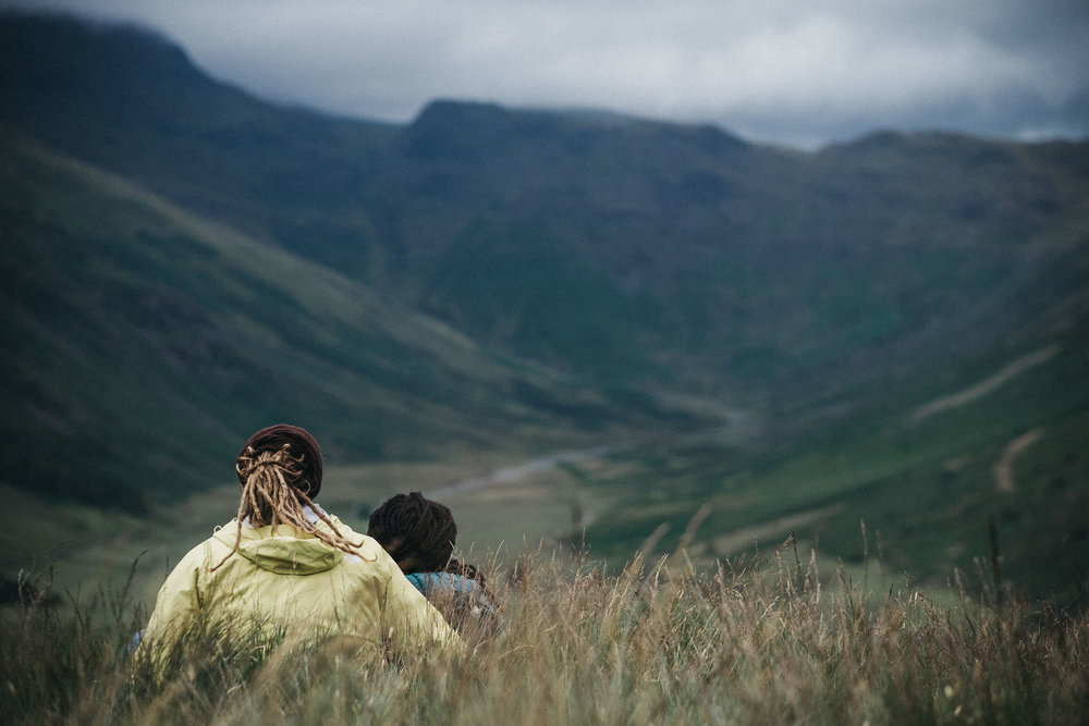 Couple look out over Lake District valley at Buttermere