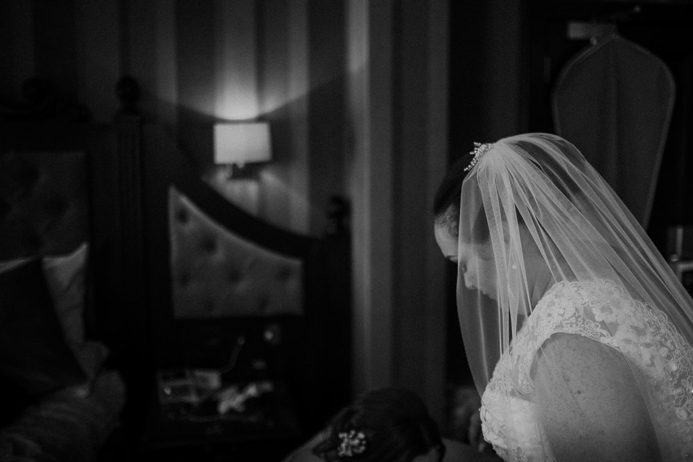Black and white photo of bride about to leave for her wedding ceremony