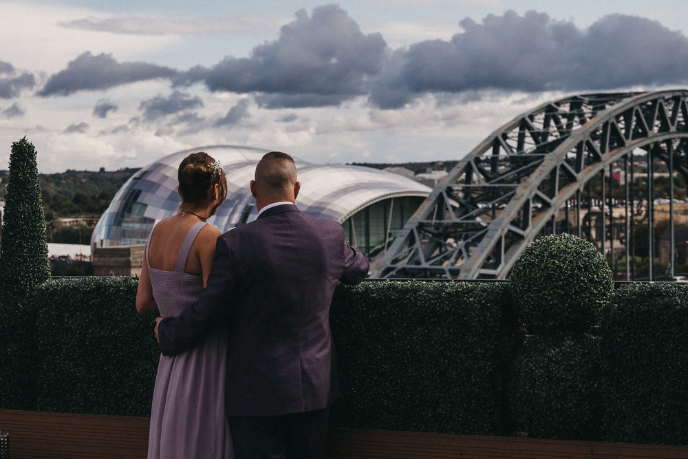 Guests looking out over the Tyne Bridge and Sage from the Vermont Hotel