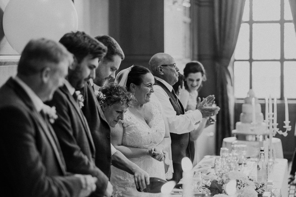 Black and white photo of bride arrival at the top table