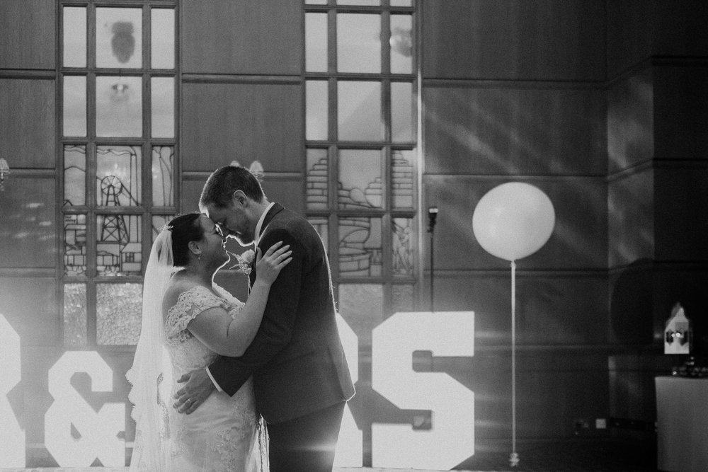 Black and white photo of bride and groom first dance at Vermont Hotel
