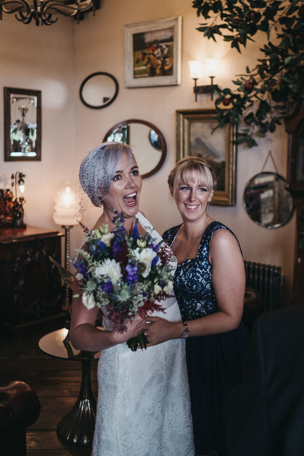 Bride pulls a funny face with guest at wedding