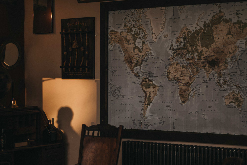 Shadow of guest on wall with world map