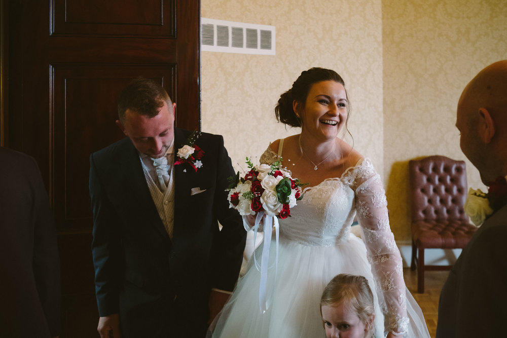 Bride laughs as she speaks to guests