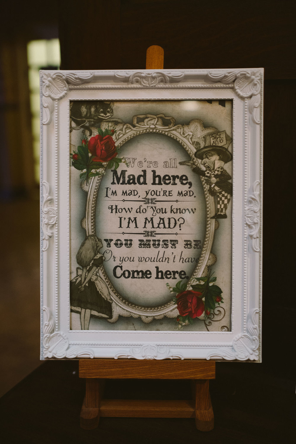 Wedding sign with quote from Alice in Wonderland