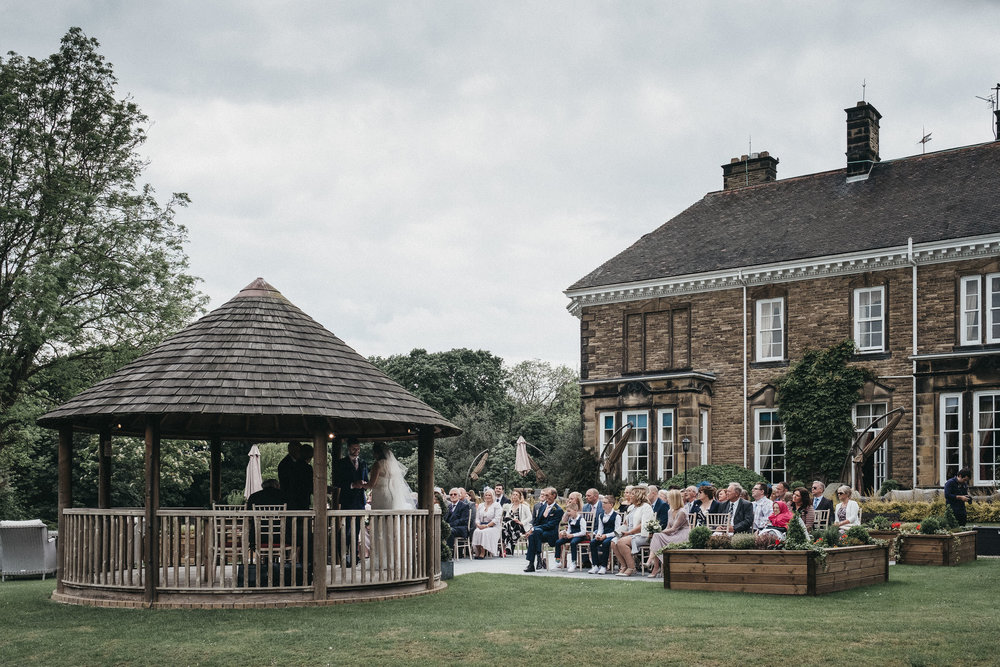 Wedding ceremony taking place in the gazebo at Judges at Kirklevington