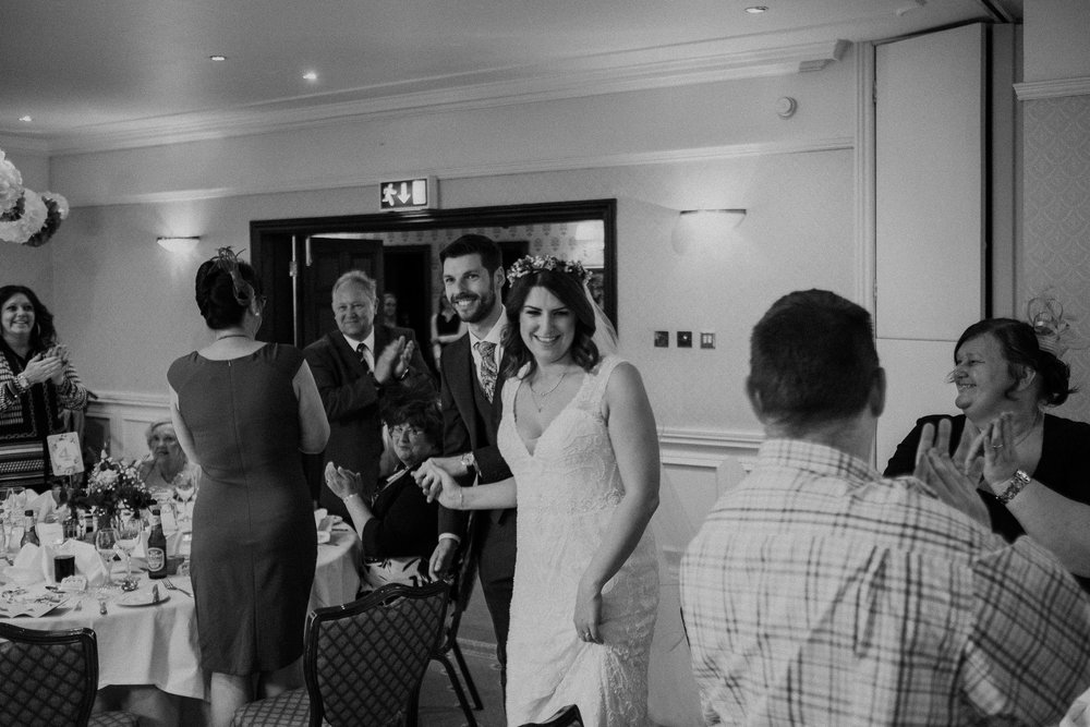 Black and white photo of bride and groom entrance
