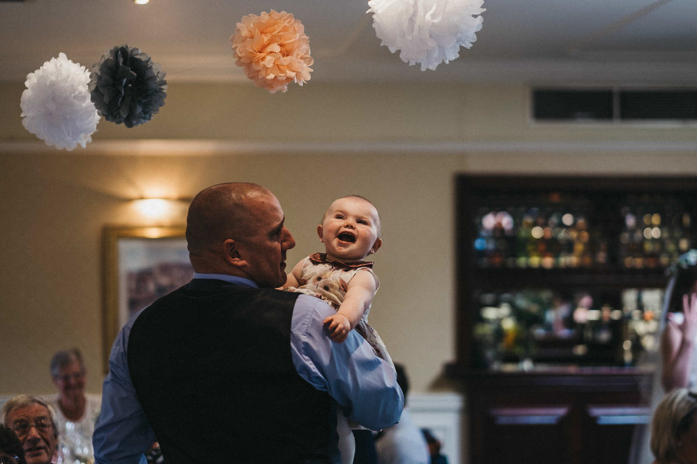 Baby laughing during wedding reception