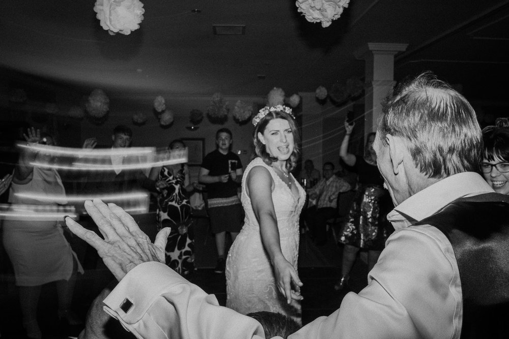 Black and white photo of bride and father of the bride dancing