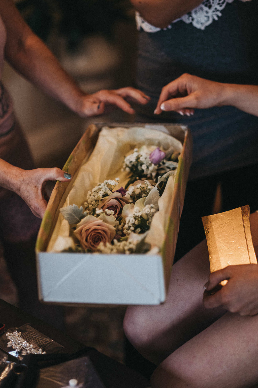 Buttonhole flowers arrive at bride's home
